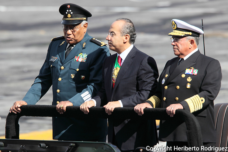 Mexican President Felipe Calderon (C),  along with Defense minister General Guillermo Galvan (L) and Almirante Mariano Francisco Saynez ride on a humbee during the military parade in the Mexico City's main square Zocalo, September 16.  Photo by Heriberto Rodriguez