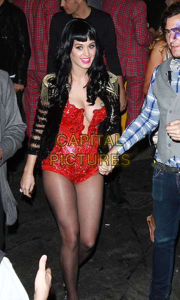 KATY PERRY .Attending Perez Hilton's Carn-Evil 32nd Birthday Party held at Paramount Studios, Los Angeles, California, USA, 27th March 2010..arrivals half 3/4 length black jacket red cleavage cut out low bodice leotard body tights gold military costume epaulettes beaded walking sparkly sequined sequin .CAP/ADM/TC.©T.Conrad/Admedia/Capital Pictures