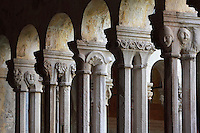 Cloister, built in late Romanesque style by Mihoje Brajkov of Bar in 1360, with a colonnade of pairs of 8-sided columns with different capitals, portraying human heads, animals, grotesques and floral motifs, at the Franciscan monastery on Stradun or Placa, Old Town, Dubrovnik, Croatia. The city developed as an important port in the 15th and 16th centuries and has had a multicultural history, allied to the Romans, Ostrogoths, Byzantines, Ancona, Hungary and the Ottomans. In 1979 the city was listed as a UNESCO World Heritage Site. Picture by Manuel Cohen