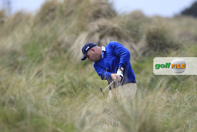 Gary Murphy (Flogas Ambassador and former European Tour player) in the rough on the 7th during the Flogas Irish Amateur Open Championship Am-Am at Royal Dublin on Monday 9th May 2016.<br /> Picture:  Thos Caffrey / www.golffile.ie