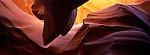 Noonday sun illuminates eroded sandstone of Slot Canyon