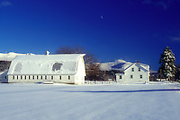 AJ5963, barn, farm, winter scene, snow, Mt. Mansfield, Vermont, A large white barn and farmhouse on a snow covered farm with Mount Mansfield in the distance under the moon against a clear blue sky in winter in Underhill in Chittenden County in the state of Vermont.