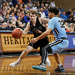 SIOUX FALLS, SD - MARCH 9:  Alex Borchers #22 of Morningside drives toward Xavier Cannefax #32 of Warner Pacific at the 2018 NAIA DII Men's Basketball Championship at the Sanford Pentagon in Sioux Falls. (Photo by Dick Carlson/Inertia)
