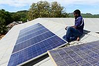 UGANDA, Karamoja, Loyoro village, installation of solar panels