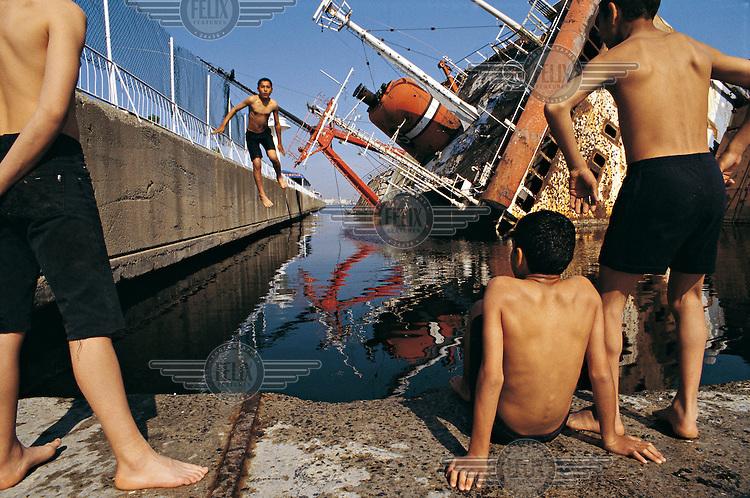 Children swim in Istanbul harbour.