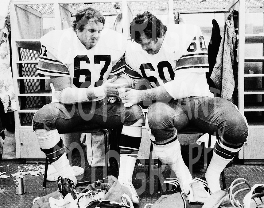 Jim Coode and Jeff Turcotte Ottawa Rough Riders 1977.. Copyright photograph Scott Grant/