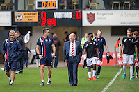 Cheltenham manager Gary Johnson (centre) walks to the dugout with his staff ahead of the Sky Bet League 2 match between Newport County and Cheltenham Town at Rodney Parade, Newport, Wales on 10 September 2016. Photo by Mark  Hawkins / PRiME Media Images.