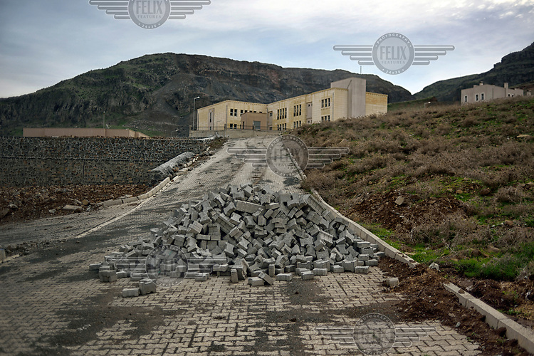 A school built in the new village of Koctepe where the residents of the old Koctepe will move once the Ilusu hydroelectric dam is complete. The reservoir created by the dam will be approximately of 313 km2 (121 sq mi) and it will flood several villages and the town of Hasankeyf.
