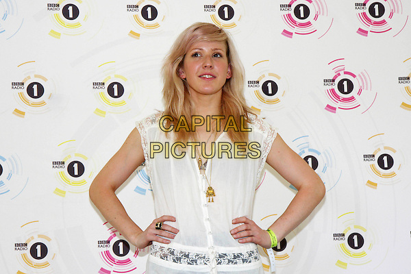 ELLIE GOULDING.At Radio One's Big Weekend, Bangor, North Wales, England. .May 22nd 2010.1 1's half length white sheer top gold necklace hands on hips.CAP/MAR.© Martin Harris/Capital Pictures.