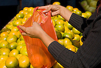 Vendor selling oranges in Chinese market, Shanghai