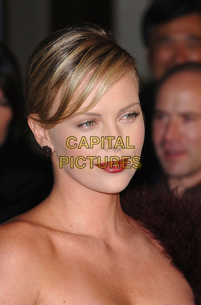 "CHARLIZE THERON.The premiere of the film ""Aeon Flux"" at Cinerama Dome theatre, Hollywood, CA, USA..December 1st, 2005..Ref: MOO.headshot portrait red lipstick .www.capitalpictures.com.sales@capitalpictures.com.©Capital Pictures."