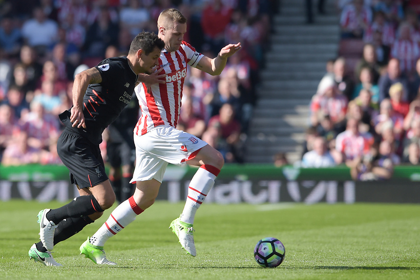 Stoke City's Ryan Shawcross vies for possession with Liverpool's Dejan Lovren<br /> <br /> Photographer Terry Donnelly/CameraSport<br /> <br /> The Premier League - Stoke City v Liverpool - Saturday 8th April 2017 - bet365 Stadium - Stoke-on-Trent<br /> <br /> World Copyright &copy; 2017 CameraSport. All rights reserved. 43 Linden Ave. Countesthorpe. Leicester. England. LE8 5PG - Tel: +44 (0) 116 277 4147 - admin@camerasport.com - www.camerasport.com