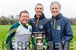 Lispole management team Seán Ó Deargáin, Antóin Ó hAimhirghin and Gabriel Ó Cathasaigh are pictured with the Munster Junior B Club Football Cup following their sides victory over Ballyhooley in Knockaderry