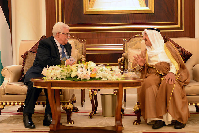 Palestinian President Mahmoud Abbas, Left, speaks with the Emir of Kuwait Sheikh Sabah al-Ahmad al-Sabah upon his arrival to Kuwait, on April 15, 2013. Abbas will inaugurate the Palestinian embassy in Kuwait since 22 years after it was shut down. Photo by Thaer Ganaim
