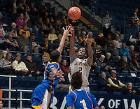 Afure Jemerigbe of California dribbles the ball during the game against Bakersfield at Haas Pavilion in Berkeley, California on December 15th, 2013.  California defeated Bakersfield Roadrunners, 70-51.