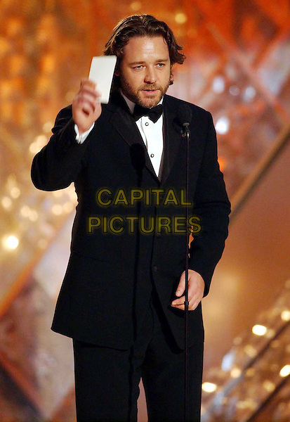 RUSSELL CROWE..Golden Globe Awards 2002..Ref: AW..presenting award, beard, half length, half-length..www.capitalpictures.com..sales@capitalpictures.com..©Capital Pictures