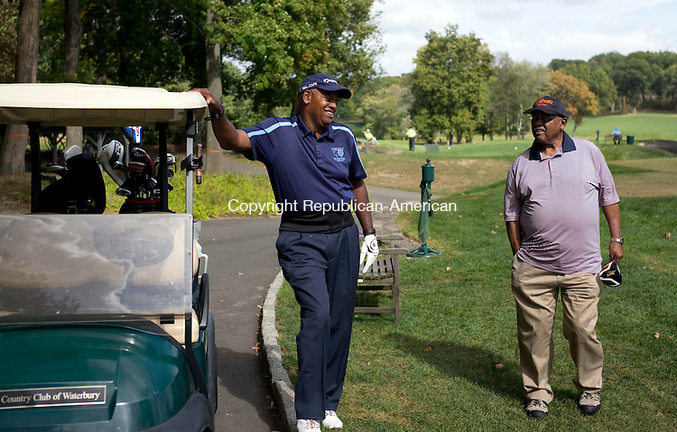 Waterbury, CT- 29 September 2015-092915CM03- <br /> James H. Gatling, left, president and CEO of New Opportunities, and George Holmes of Naugatuck, share a laugh at the 6th tee, during the 21st annual Bobby Bonds Memorial Scholarship Golf Tournament at the Country Club of Waterbury on Tuesday.  The event, which is sponsored by New Opportunities Inc. is held to raise money for their scholarship programs.      Christopher Massa Republican-American
