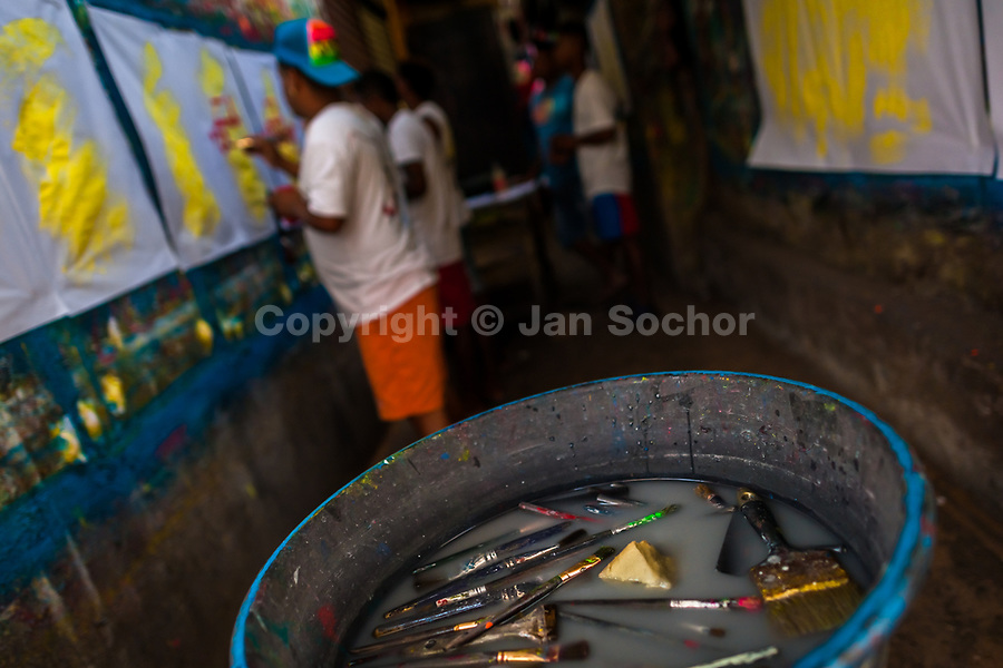 "Painting brushes are seen floating in the rinse water basin in the sign painting workshop in Cartagena, Colombia, 15 April 2018. Hidden in the dark, narrow alleys of Bazurto market, a group of dozen young men gathered around José Corredor (""Runner""), the master painter, produce every day hundreds of hand-painted posters. Although the vast majority of the production is designed for a cheap visual promotion of popular Champeta music parties, held every weekend around the city, Runner and his apprentices also create other graphic design artworks, based on brush lettering technique. Using simple brushes and bright paints, the artisanal workshop keeps the traditional sign painting art alive."