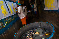 """Painting brushes are seen floating in the rinse water basin in the sign painting workshop in Cartagena, Colombia, 15 April 2018. Hidden in the dark, narrow alleys of Bazurto market, a group of dozen young men gathered around José Corredor (""""Runner""""), the master painter, produce every day hundreds of hand-painted posters. Although the vast majority of the production is designed for a cheap visual promotion of popular Champeta music parties, held every weekend around the city, Runner and his apprentices also create other graphic design artworks, based on brush lettering technique. Using simple brushes and bright paints, the artisanal workshop keeps the traditional sign painting art alive."""