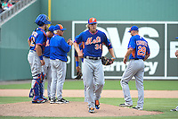 New York Mets pitcher Noah Syndergaard (34) walks off the field as manager Terry Collins makes a pitching change with catcher Kevin Plawecki (22) and Eric Campbell (29) looking on during a Spring Training game against the Boston Red Sox on March 16, 2015 at JetBlue Park at Fenway South in Fort Myers, Florida.  Boston defeated New York 4-3.  (Mike Janes/Four Seam Images)