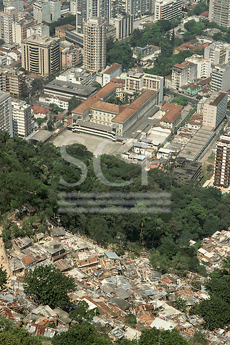 Rio de Janeiro, Brazil. Dona Marta shanty town 'favela' in the foreground with the Santo Ignacio school and high-rise buildings behind; view looking south west.