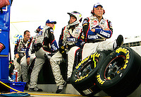 Members of Team Lowe's, the no. 48 Lowe's Chevy Monte Carlo driven by Jimmie Johnson, wait out the rain at the Lowe's Motor Speedway, in Concord, NC, during the 2009 Coca-Cola Classic 600 NASCAR race. Driver David Reutimann won his first Cup race during the rain-shortened event, held May 25, 2009. NASCAR's longest scheduled race went only 227 laps, or 340.5 miles, before officials ended it because of rain. The 2009 race was the 50th running of the Coca-Cola 600. Ryan Newman and Robby Gordon finished second and third respectively.