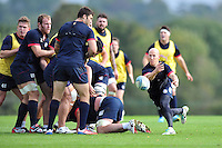 Peter Stringer passes the ball. Bath Rugby training session on October 17, 2013 at Farleigh House in Bath, England. Photo by: Patrick Khachfe/Onside Images