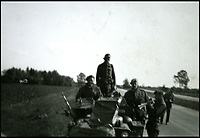 BNPS.co.uk (01202 558833)<br /> Pic: Bellmans/BNPS<br /> <br /> 2 SAS on an German Autobahn in 1945 'returning from a job near Hanover'.<br /> <br /> A fascinating trove of SAS records including some of the first photographs of the elite force which have never been seen before has been unearthed. <br /> <br /> The extensive assortment, also including medals and documents, was accumulated by war hero Lance Corporal William James Cooke at the end of World War Two. <br /> <br /> Remarkable images of Cooke's previously unrevealed wartime exploits show him serving behind enemy lines in occupied France and assisting with the liberation of Norway. <br /> <br /> His accomplishments have come to light after a family member presented the bequeathed collection to Hampshire-based auctioneer Bellmans, which will sell it tomorrow.