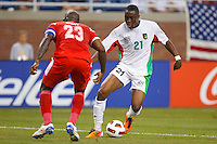 Guadeloupe forward Richard Socrier (21) dribbles the ball at Panama defender Felipe Baloy (23)  during the CONCACAF soccer match between Panama and Guadeloupe at Ford Field Detroit, Michigan.