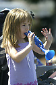 Girl watching the parade at Whaling Days, Silverdale, WA Kitsap County community event. Stock photography by Olympic Photo Group