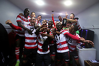 Kingstonian celebrate in the dressing room after the game during Macclesfield Town vs Kingstonian, Emirates FA Cup Football at the Moss Rose Stadium on 10th November 2019