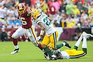Landover, MD - September 23, 2018: Washington Redskins running back Adrian Peterson (26) stiff arms Green Bay Packers cornerback Jaire Alexander (23) during the  game between Green Bay Packers and Washington Redskins at FedEx Field in Landover, MD.   (Photo by Elliott Brown/Media Images International)