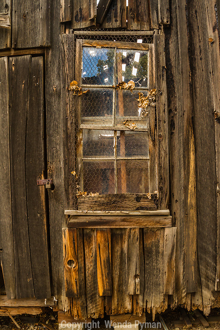 Detail of a weathered window on an old house, Eastern California Museum
