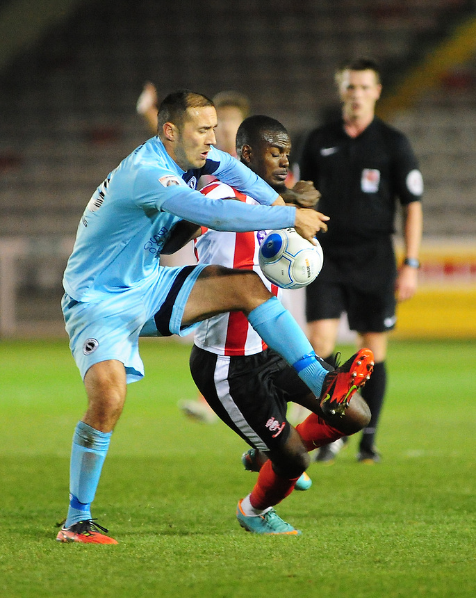Lincoln City&rsquo;s Theo Robinson vies for possession with Boreham Wood's Joe Devera<br /> <br /> Photographer Andrew Vaughan/CameraSport<br /> <br /> Vanarama National League - Lincoln City v Boreham Wood - Tuesday 25th October 2016 - Sincil Bank - Lincoln<br /> <br /> World Copyright &copy; 2016 CameraSport. All rights reserved. 43 Linden Ave. Countesthorpe. Leicester. England. LE8 5PG - Tel: +44 (0) 116 277 4147 - admin@camerasport.com - www.camerasport.com