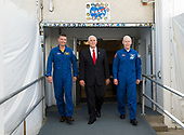 In this photo released by the National Aeronautics and Space Administration (NASA) United States Vice President Mike Pence, center, and NASA astronaut Reid Wiseman, left, and NASA astronaut Pat Forrester, right, walk out of the historic crew doors at Kennedy Space Center's (KSC) Operations and Checkout Building on Thursday, July 6, 2017, in Cape Canaveral, Florida. These are the same doors that Apollo and space shuttle astronauts walked through on their way to the launch pad. <br /> Mandatory Credit: Aubrey Gemignani / NASA via CNP