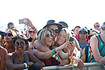 Fans take a selfie as Chet Faker performs on stage at Weekend 1 of the Coachella Valley Music and Arts Festival in Indio, California April 11, 2015. (Photo by Kendrick Brinson)