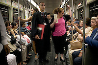 Nick Culbertson (center), sister Ashley Lyles (left center)and mother Leticia Culbertson (right center) ride a subway to lunch after attending the graduation of Nick Culbertson, of Dunellen, New Jersey, at the Quincy House ceremony during Harvard University Commencement on May 26, 2011, in Cambridge, Massachusetts, USA.<br /> <br /> Photo: M. Scott Brauer for the Star-Ledger