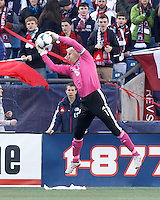 Sporting Kansas City goalkeeper Jimmy Nielsen (1) grabs a crossed ball.  In a Major League Soccer (MLS) match, Sporting Kansas City (blue) tied the New England Revolution (white), 0-0, at Gillette Stadium on March 23, 2013.