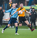 Alloa's Mark Docherty holds off Forfar's Jordan Brown.
