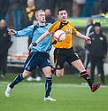 Alloa's Mark Docherty holds off Forfar's Jordan Brown.