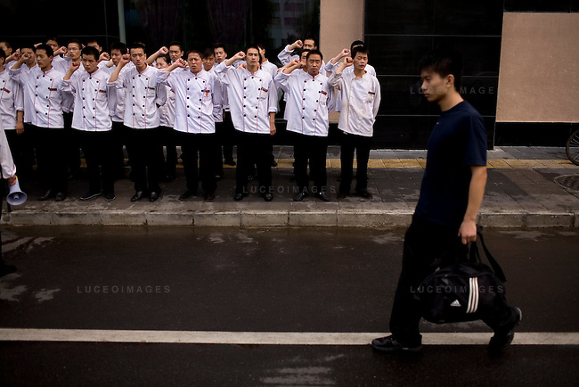 Restaurant employees take orders from management gearing up for Olympic Games' customers in Beijing, China on Thursday, August 7, 2008. The city of Beijing is gearing up for the opening ceremonies of the Olympic Games.  Kevin German