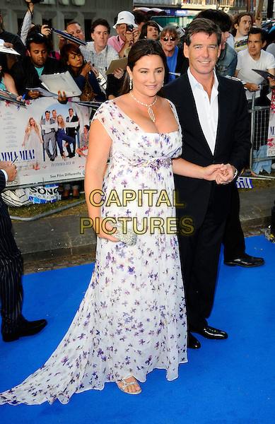 """KEELEY SHAYE-SMITH & PIERCE BROSNAN .Arrivals for """"Mamma Mia!"""" World Film Premiere at the Odeon Cinema, Leicester Square, London, England, UK,.June 30th, 2008 .full length married husband wife couple white purple floral print dress black suit shirt necklace earrings long maxi holding hand.CAP/CAN.©Can Nguyen/Capital Pictures"""