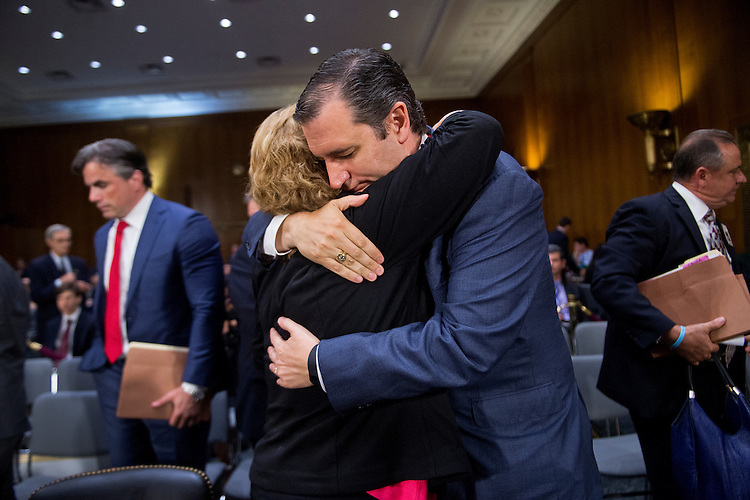 "UNITED STATES - JULY 21: Sen. Ted Cruz, R-Texas, hugs Laura Wilkerson, mother of Josh Wilkerson, who was killed by an undocumented man in Texas in 2010, during a Senate Judiciary Committee hearing in Dirksen Building titled ""Oversight of the Administration's Misdirected Immigration Enforcement Policies: Examining the Impact on Public Safety and Honoring the Victims,"" July 21, 2015. The hearing featured testimony of families of victims who were killed by undocumented immigrants. (Photo By Tom Williams/CQ Roll Call)"