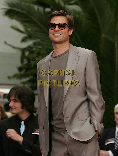 BRAD PITT.The Warner Brothers Pictures Hand & Foot Print Ceremony for The Cast of Ocean's Thirteen held at The Grauman's Chinese Theatre in Hollywood, California, USA..June 5th, 2007                     .half length hands in pockets beige suit jacket sunglasses shades .CAP/DVS.©Debbie VanStory/Capital Pictures