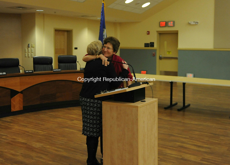 """TORRINGTON, CT- 7 December 2015- 08120715BJ02-- Republican Anne Ruwet hugs Mayor Elinor Carbone after reciting the oath of office for her new term on the City Council on Monday at City Hall. Ruwet and 21 other residents took the oath of office for various boards and positions, including constables, selectmen, Board of Education, Board of Public Safety, City Council and treasurer. The mayor told the city officials the oath is a """"life-changing commitment to the city."""" Bruno Matarazzo Jr. Republican-American"""