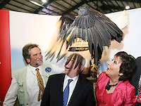27/1/2012                              ***** No Fee Photos ******Lothar Muschketat with a Bald Eagle, from  Eagles Flying, Sligo,with Minister of State at the Department of Tourism, Michael Ring TD, and  Maureen Ledwith  (MD Holiday World) at the Louth Stand at the opening of the Holiday World Show Dublin at the RDS Simmonscourt. Celebrating its 23rd year, the Holiday World Show is expected to attract a crowd of over 50,000 people who will pick up great holiday bargains for 2012.Pic Collins Photos