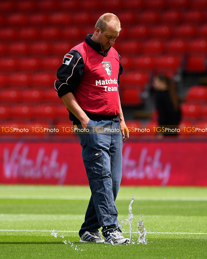 A groundsman treads down a water sprinkler  during AFC Bournemouth vs Valencia CF, Friendly Match Football at the Vitality Stadium on 30th July 2017