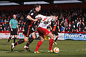 Dani Lopez of Stevenage escapes from Neill Collins of Sheffield United on his way to score their first goal. Stevenage v Sheffield United - npower League 1 -  Lamex Stadium, Stevenage - 16th March, 2013. © Kevin Coleman 2013.. . . .
