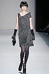 Wang Xiao walks the runway in a Nicole Miller Fall 2011 outfit, during Mercedes-Benz Fashion Week.
