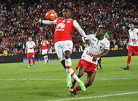 BOGOTA -COLOMBIA, 4-03-2017.Johan Arango (L)  player of Independiente Santa Fe fights the ball against of Edgarto Rito  (R) player of Patriotas FC during match for the date 8 of the Aguila League I 2017 played at Nemesio Camacho El Campin stadium . Photo:VizzorImage / Felipe Caicedo  / Staff